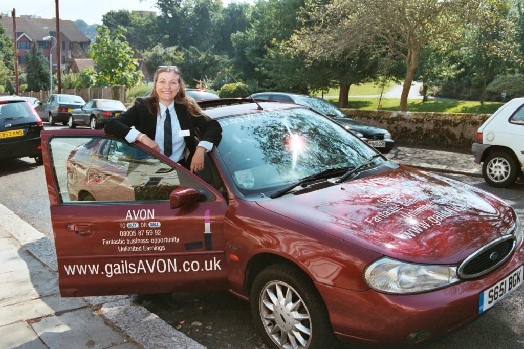 The older sign written Avon car